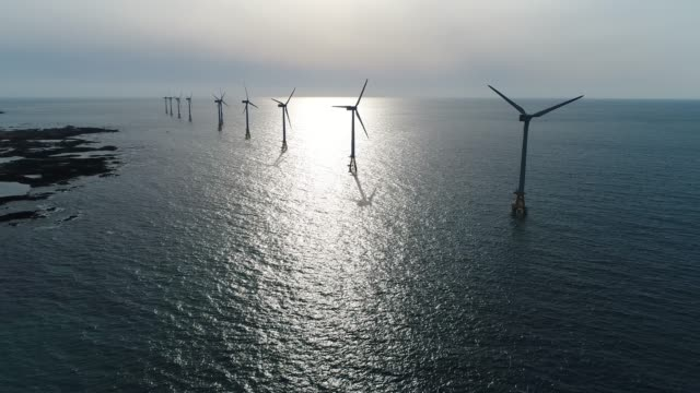 Landscape of offshore wind farm, seascape with turbines from aerial, Jeju island, South Korea, Asia