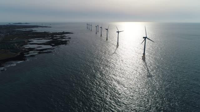 landscape of offshore wind farm, seascape with turbines from aerial, jeju island, south korea, asia - sustainability video stock e b–roll