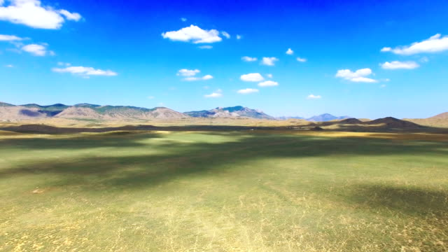 AERIAL: Landscape of steppes and hills on blue sky background video