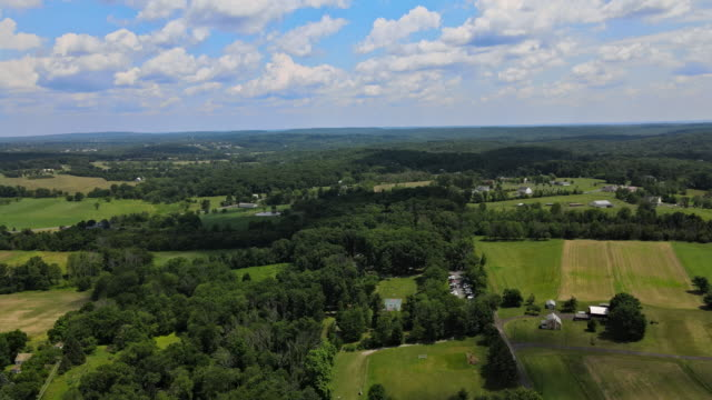 Landscape panoramic view of farm fields the mountains forests blue sky in the Pocono of Pennsylvania.