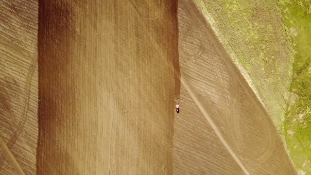 landscape shot using drone. The field with the tractor. Tractor plowing land. video