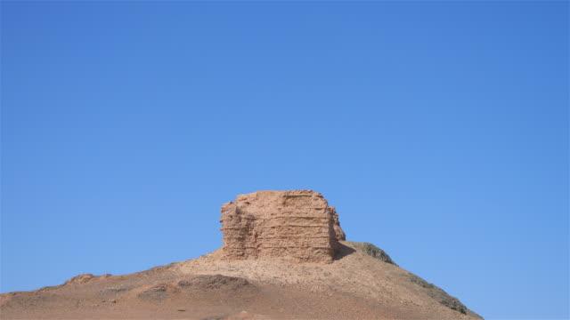 Landscape view of ancient Yangguan pass on the silk road in Gansu China. Chinese translation : Yangguan fire beacon tower.