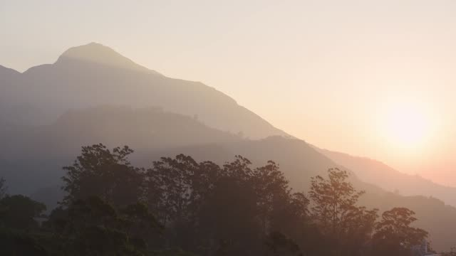Landscape view of mountains and hills on a misty morning, in Munnar, India