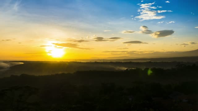 Landscape view of sunrise above mountain with colorful cloudy sky