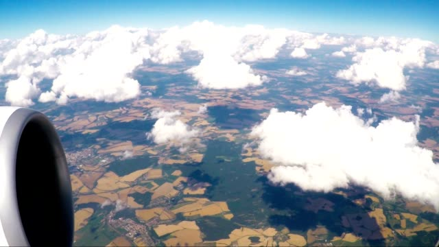 landscape view window of flying airliner video