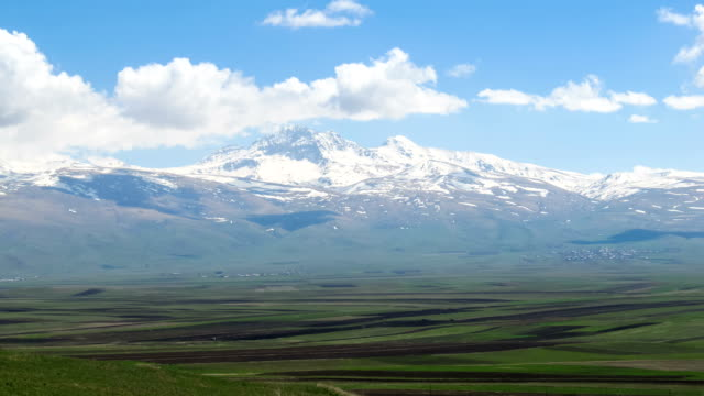 Landscapes and Mountains of Armenia. Clouds move over the Snowy Peaks of the Mountains in Armenia. Time lapse video