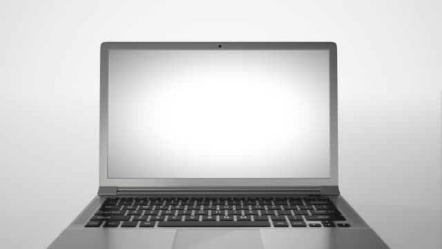 Laptop 4K on a white background turns and lights up video