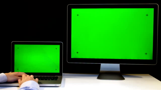 Laptop and Display with a Green Screen video
