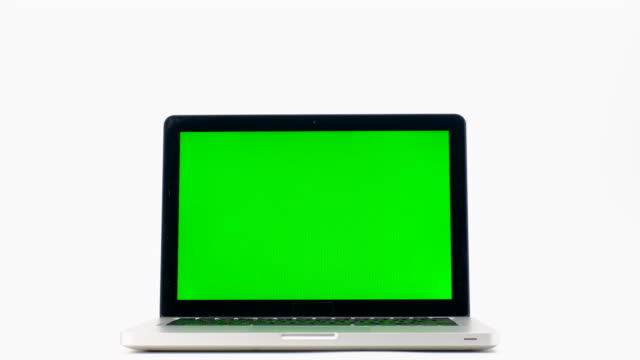 Laptop computer with a key green screen isolated on white background. 4k Resolution