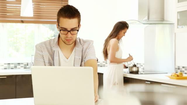 Laptop couple kitchen. video