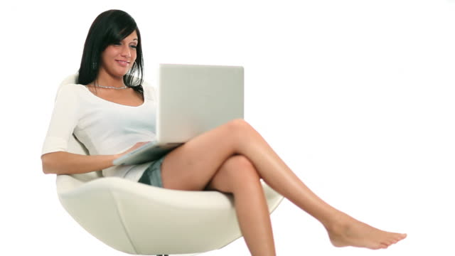 Laptop Girl Young woman with laptop over a white background. cross legged stock videos & royalty-free footage