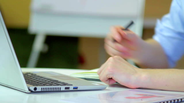 Laptop hands of businessman type and write notes, commercial man video