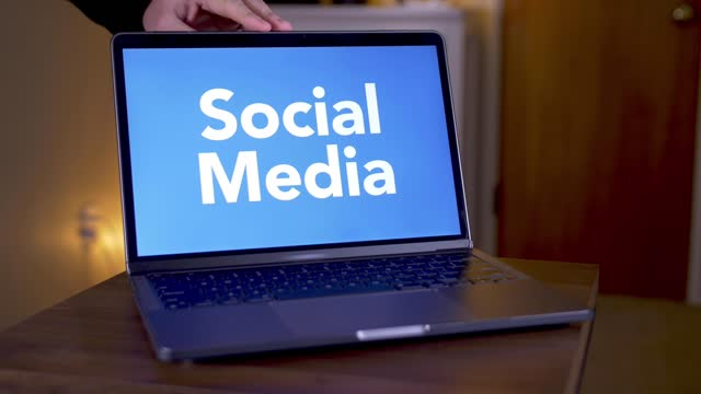 Laptop Opens Showing Social Media