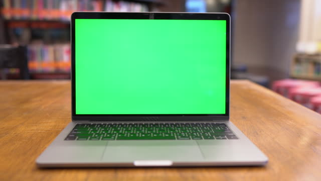 Video Laptop with green screen in library, Chroma key