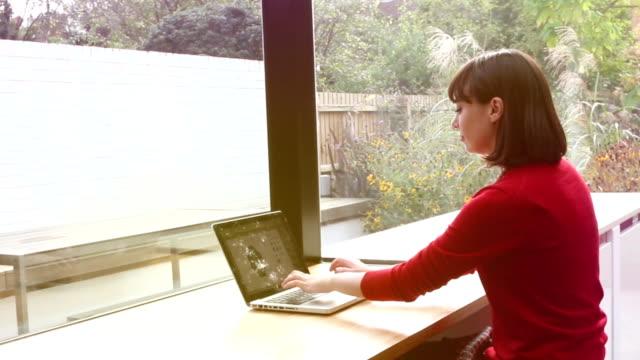 Laptop woman modern home. Handheld. video