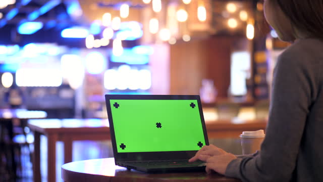 Laptop Works on a Mock-up Green Screen