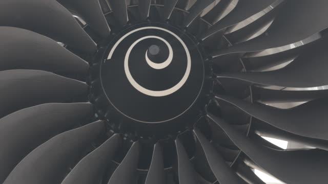 Large airplane turbine turns slowly