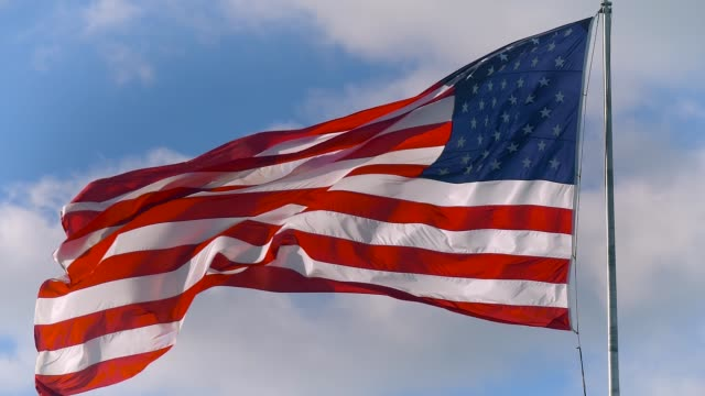 Large American flag gently waving in the wind video