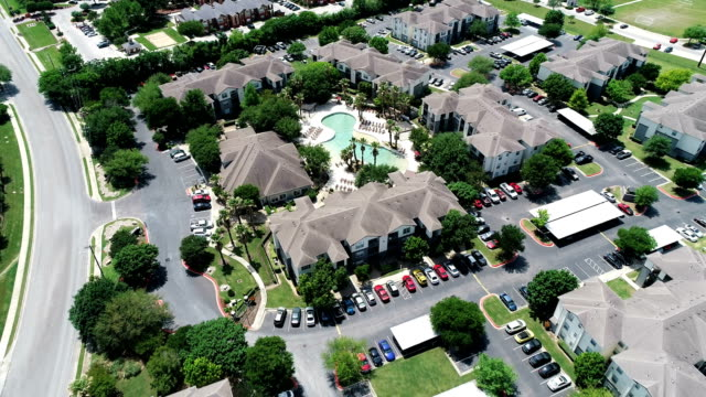 Large Apartment Condo Suburb New Development Living looking down from high above Drone View Aerial Drone view above Large Apartment Condo Suburb New Development Living - San Marcos , Texas , USA - looking down from high above Drone View house rental stock videos & royalty-free footage