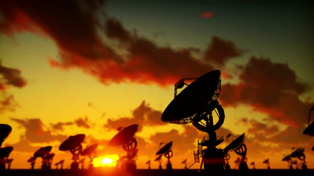 Large Array Radio Telescope. Time-lapse of a radio telescope in desert at sunset.