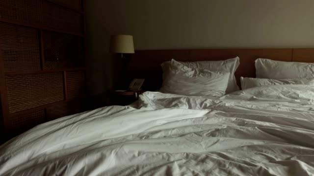 large bed with white linen large bed with white linen double bed stock videos & royalty-free footage
