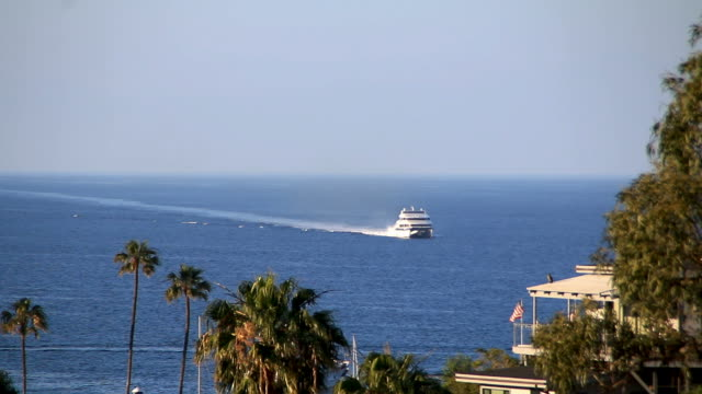 Large boat arriving to Catalina Island in California on sunny day video