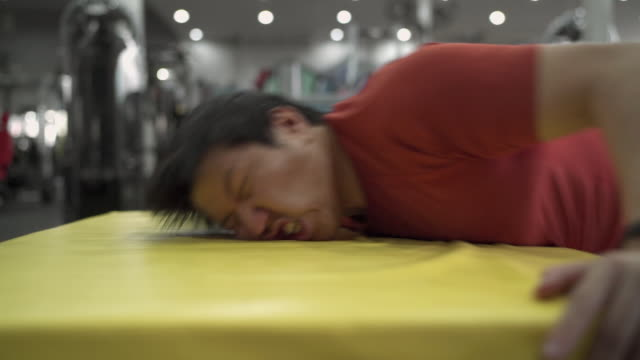 SLO MO - Large Build Asian Man Fail to Jump on Plyo Box