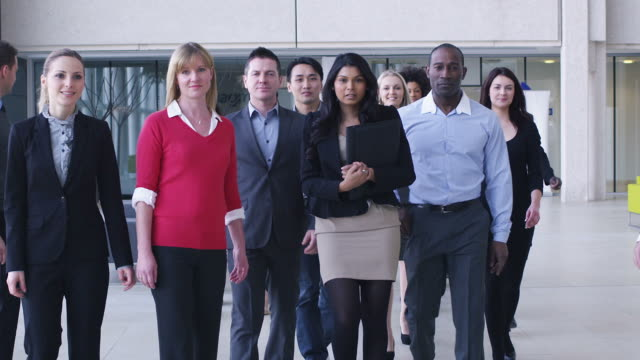 Large business team smile into camera video