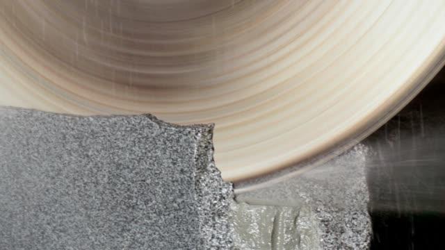 Large circular saw cuts a granite block. Granite plant. Large circular saw cuts a granite block. workbench stock videos & royalty-free footage