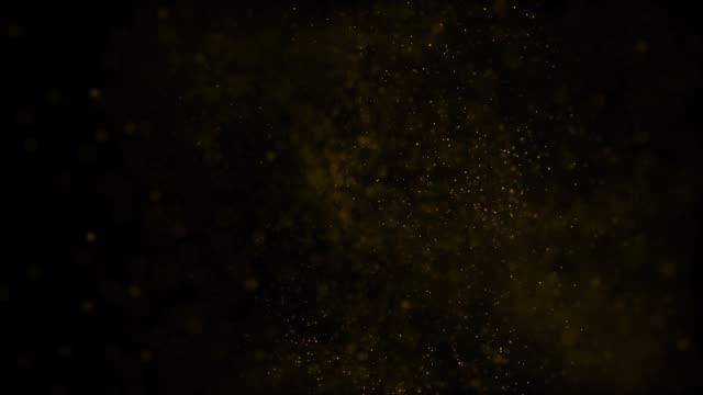 stockvideo's en b-roll-footage met een grote cluster van goudkleurige microdeeltjes op een zwarte achtergrond hd 1920x1080 - meerdere lagen effect