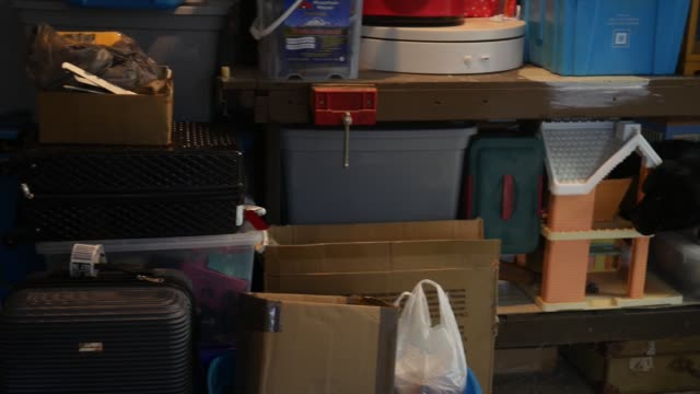 A large collection of junk from a home owners basement in unfinished area of room - vídeo