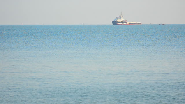 Large container ship in deep blue ocean video