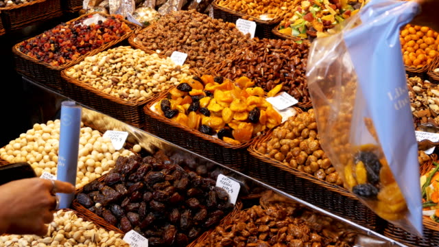 Large Counter of Dried Fruits and Nuts at a Farmers Market in La Boqueria. Barcelona. Spain video