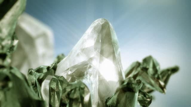Large diamond like crystal and emeralds rotating. video