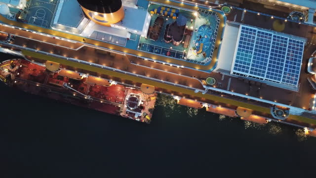 Large docked cruise ship at the sea port, top view. Stock. Sunset cruise liner with everything for the luxury vacation Large docked cruise ship at the sea port, top view. Stock. Sunset cruise liner with everything for the luxury vacation. royalty stock videos & royalty-free footage