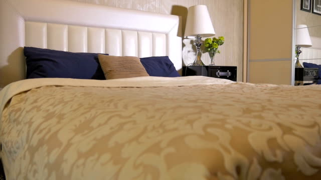 Large double bed in bedroom Elegant bedroom with a very beautiful bed. double bed stock videos & royalty-free footage