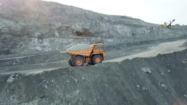 Large dump truck carries chalk ore in the quarry. Mining industry