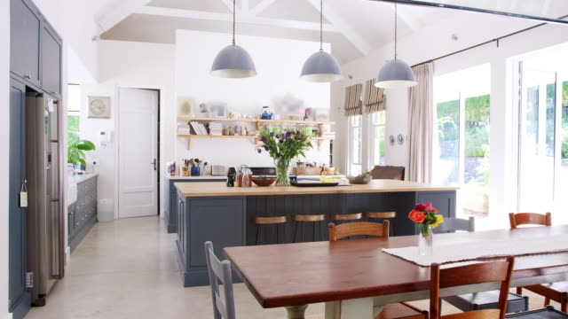 large family kitchen in a period conversion house - kitchen stock videos & royalty-free footage
