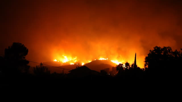 Large Fire on Hill At Night video