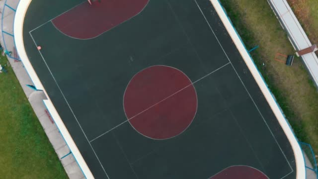 large football field with special dark green covering aerial video