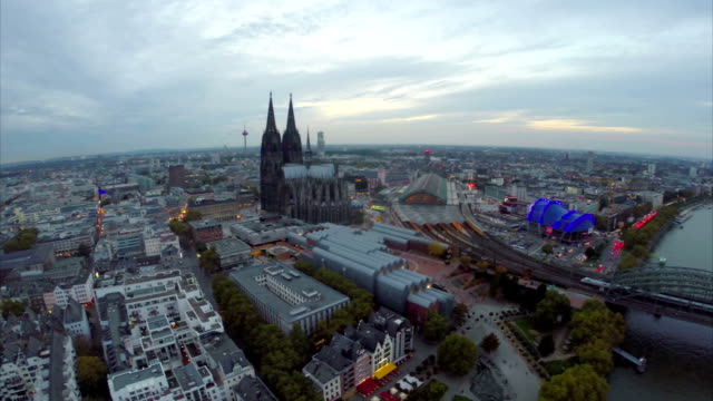 Large German city aerial, Cologne overview from above tourism. Beautiful aerial shot above Europe, culture and landscapes, camera pan dolly in the air. Drone flying above European land. Traveling sightseeing, tourist views of Germany.