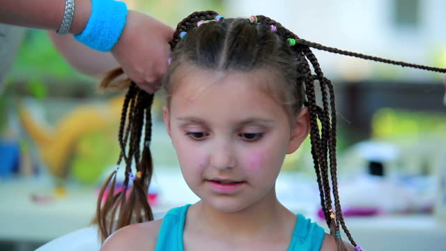 Large girl's face, which is braided pigtails video