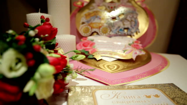 large greeting card and wedding flowers on the table video
