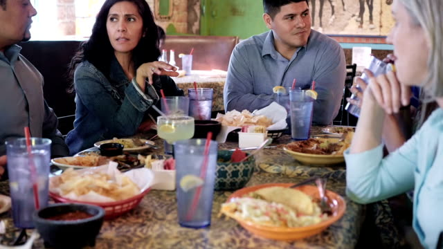 Large group of adults having dinner together in Mexican food restaurant video