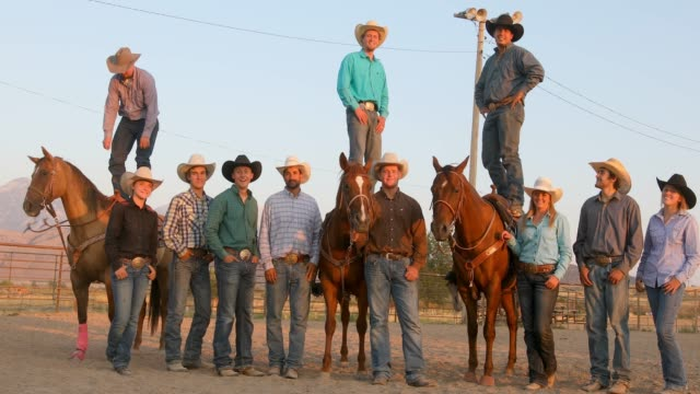 Large group of cowboys and cowgirls on horseback video