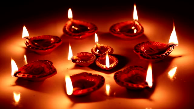 large group of oil lamps burning - diwali stock videos and b-roll footage