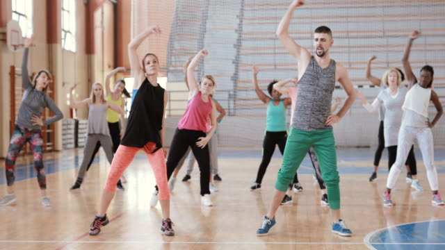 Large group of people dancing at Zumba class Large group of people dancing at Zumba class dance studio stock videos & royalty-free footage