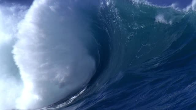 Large heavy wave breaking onto a shallow reef. Power of the nature