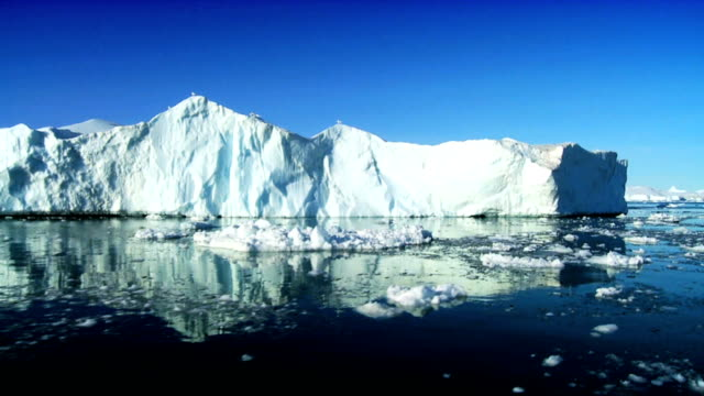 Large Iceberg Broken Away from a Glacier Large iceberg broken away from an ice glacier arctic region icecap stock videos & royalty-free footage