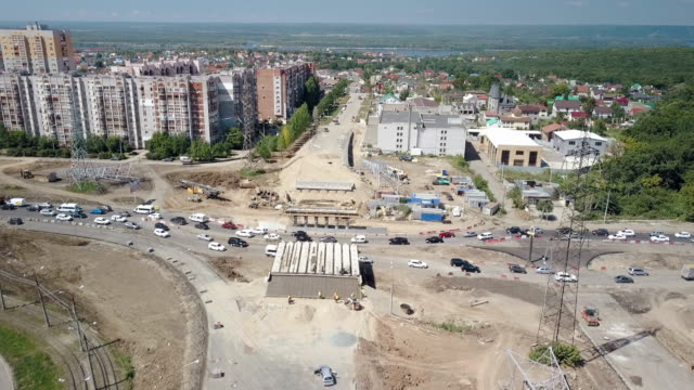 large junction under construction, aerial view, difficult car traffic, sunny summer day video